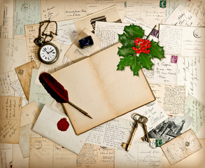 open book, old accessories and post cards