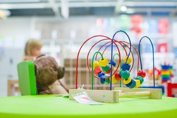 Logic toy with paths and spheres, cubes on table in mall