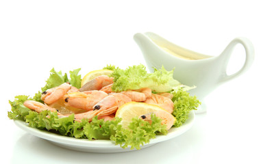 Boiled shrimps with lemon and lettuce leaves