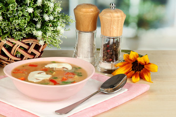 Fragrant soup in pink plate