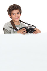 Little boy photographer with white sign