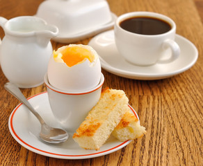 soft-boiled egg on a brown table