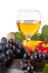 glass of white wine and various autumn fruits