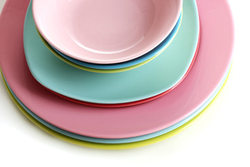 Colorful plates close-up isolated on white