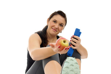 sporty woman with hantels and apple