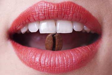 coffee bean in a female mouth