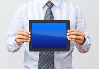 Wall Mural - Businessman working on a digital tablet