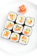 Sushi rolls with sashimi, isolated on white. Top view