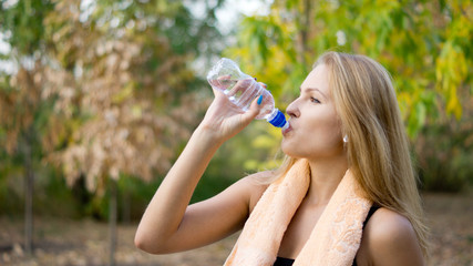 Woman drinking pure bottled water