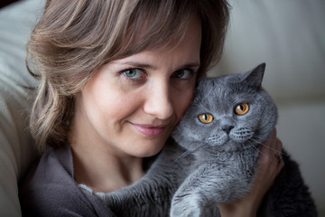 Pretty young woman with a cat
