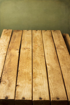 Wooden deck tabletop against grunge wall