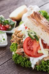 Pita bread with Kebab on wood