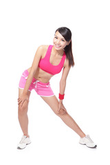 sport woman warming up and touch leg