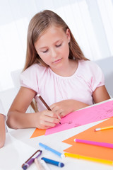 Portrait Of Girl Drawing With Colorful Markers