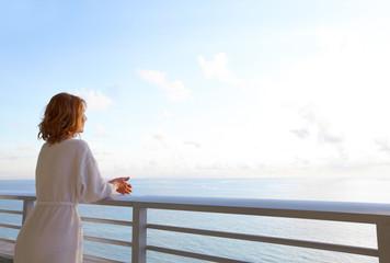 Happy woman looking on the ocean.