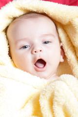 Newborn - close-up focus baby boy with yelow blanket