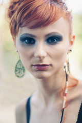 Intense beautiful red woman close up portrait.