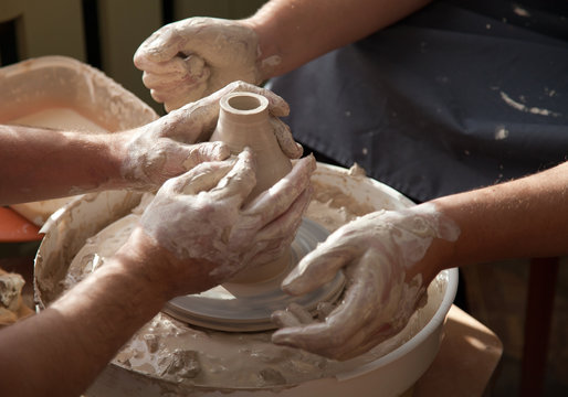 Pottery with throwing wheel