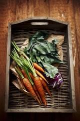 Carrots and kohlrabi on a wicker tray