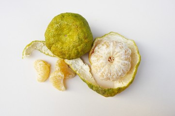 Ugli Fruit; Whole, Peeled and Segments; From Above; White Background