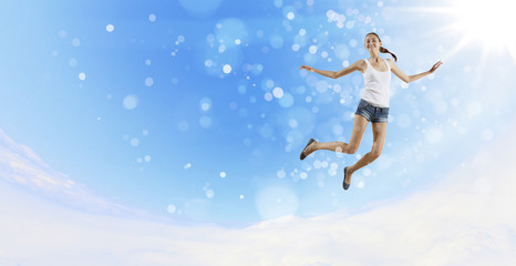 Modern style dancer against blue sky