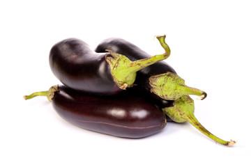Three large eggplant, over white background