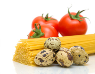 spaghetti, eggs and tomatoes close up