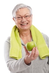 Old lady with green apple smiling
