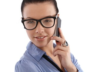 Smiling young female on mobile phone