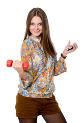 Portrait of a smiling young woman with dumbbell in one hand and