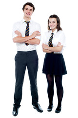 Students in uniform posing with arms crossed
