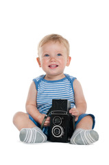 Pretty little boy with old film camera