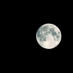 full moon on dark sky, isolated on black