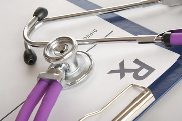 RX prescription and a stethoscope, close-up
