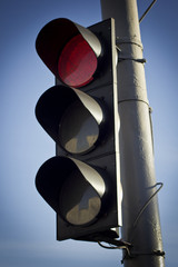 red trafficlight with pole