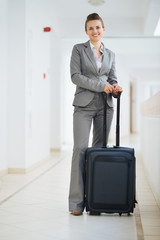 Portrait of business woman in business trip with wheel bag