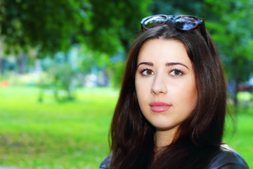 Portrait of brunette girl in the park