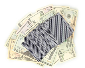 Dollars and a deck of playing cards isolated on white