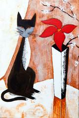 Chat noire avec un fleur