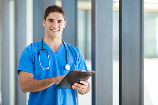 happy male healthcare worker with tablet computer
