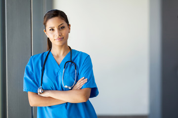 attractive young medical intern portrait in office