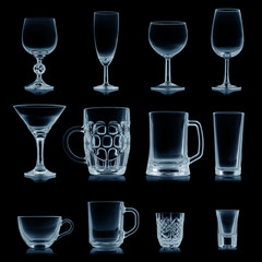 Clean empty glassware collection isolated on black