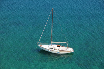 Boat in a quiet bay on Adriatic sea, from above