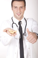 Young attractive male doctor with peanuts