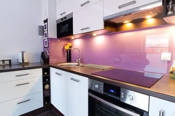 Modern white and purple kitchen interior