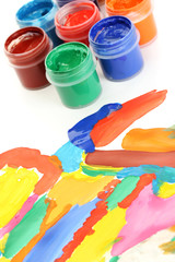 Jars with colorful gouache with a bright picture close-up