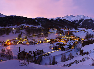 Fototapete - Mountains ski resort Solden Austria at sunset