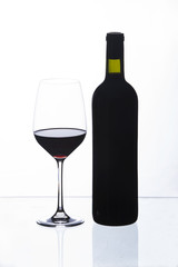 wine glass and a bottle, white background