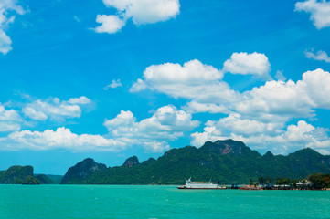Tropical sea, boat and coastline in gulf of Thailand