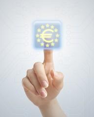 Hand pushing euro button
